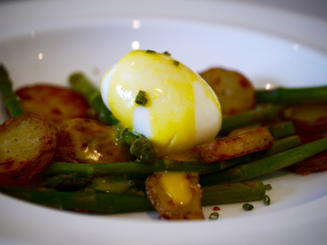 poached egg with chives and butter sauce on asparagus and potato